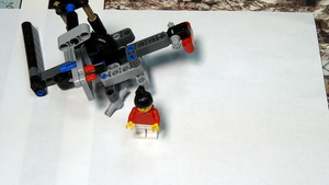 Image for Dropping a LEGO human carrier. FIRST LEGO League Trash Trek 2015
