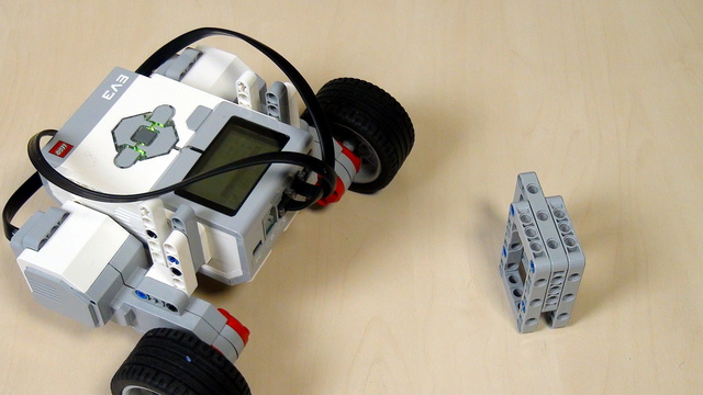 EV3 Phi. Task - bring water with the robot from a dispenser to a person
