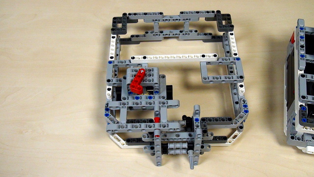 Image for Box Robot Two. Task. Build the right side attachment with vertical axle.