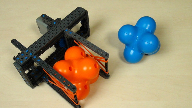Image for VEX IQ Crossover. Teacher Note. Group attachments for grabbing a hex ball