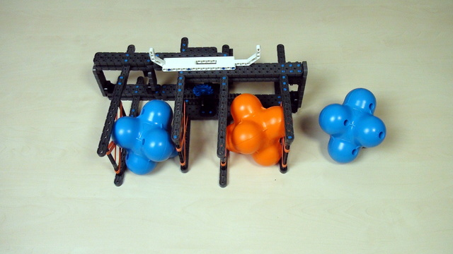 Image for VEX IQ Crossover. Teacher Note. Extend to grab a second object